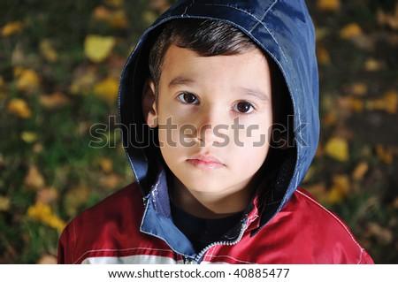 Little cute sad kid outdoor - stock photo