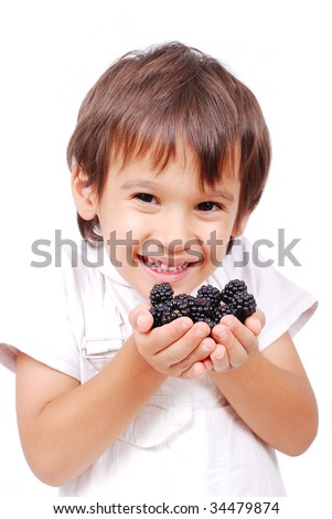 Little cute white kid with blackberry in hands - stock photo
