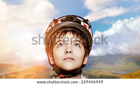 little cyclist closeup portrait over nature background collage - stock photo