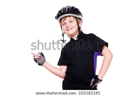 Little cyclist  pointing with his finger to the copy space - stock photo