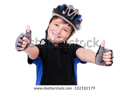 Little cyclist showing thumbs up - stock photo
