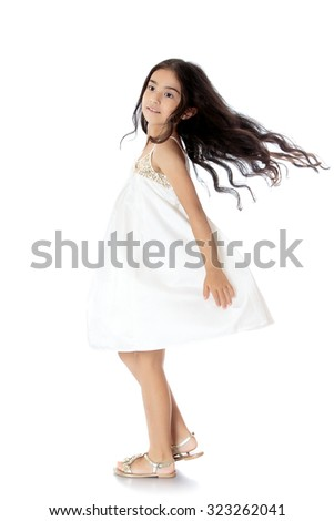 Little dark-haired girl in beautiful summer dress white dress spinning around her. During the movement of the girl developing hair-Isolated on white background - stock photo