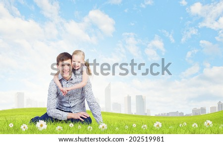 Little daughter hugging her father. Parenting concept - stock photo