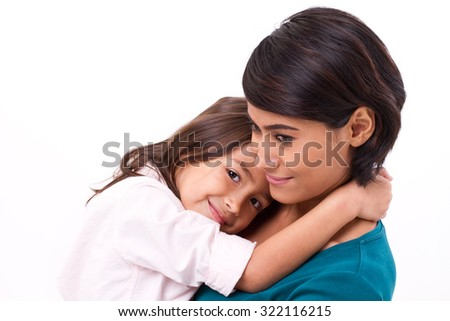 little daughter hugging her mother, concept of happy family or love - stock photo