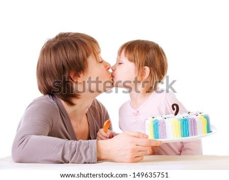Little daughter kissing her mother. torte - stock photo