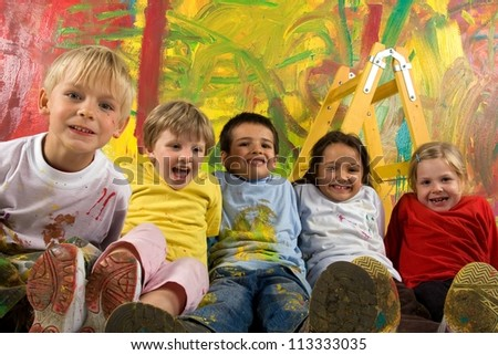 Little dirty smiling painters