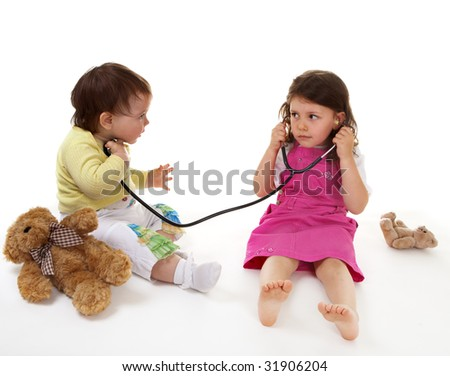 Little doctor and small patient - stock photo