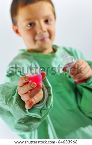 little  doctor  boy giving syrup - stock photo