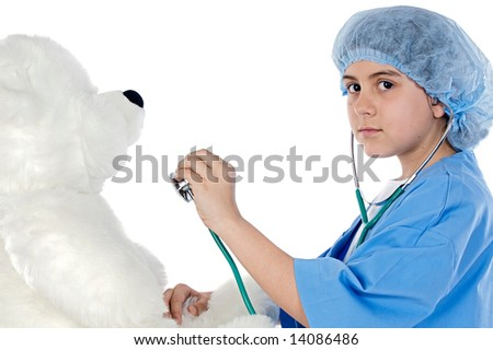Little doctor examining her teddy a over white background - stock photo