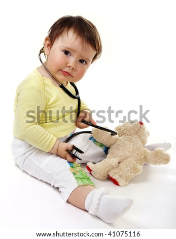 Little doctor with toy - stock photo