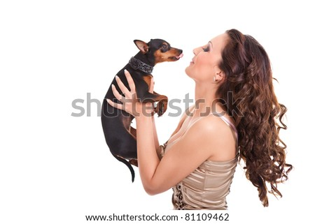little dog kissing beautiful young girl, isolated on white background - stock photo