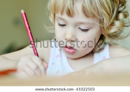 little drawing girl in soft selective focus - stock photo