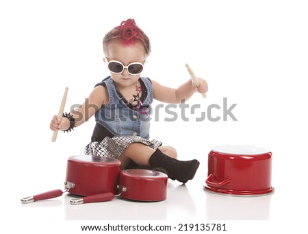 Little drummer girl.  Adorable toddler banging on pots and pans with drum sticks.  Isolated on white with room for your text.   - stock photo