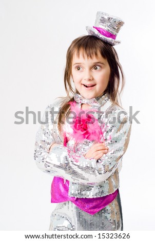 Little emotional girl in carnival clown costume