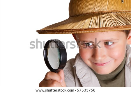 little explorer looking through the magnifying glass - stock photo