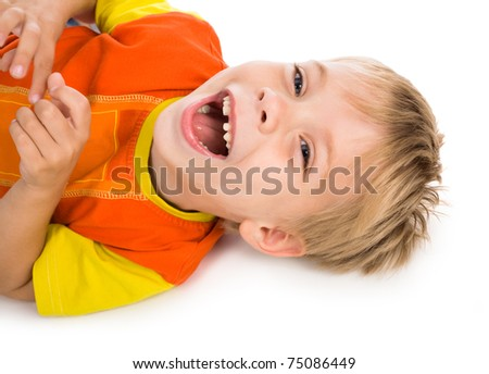 little expressive laughing boy lie on white background - stock photo