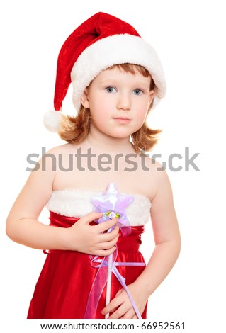 Little fairy wearing santa's hat and red dress holding magic wand - stock photo