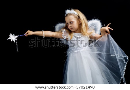 Little fairy with a magic wand on a black background - stock photo