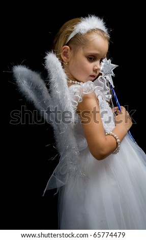 Little fairy with a magic wand on a black background.fairy-tale.Christmas. - stock photo