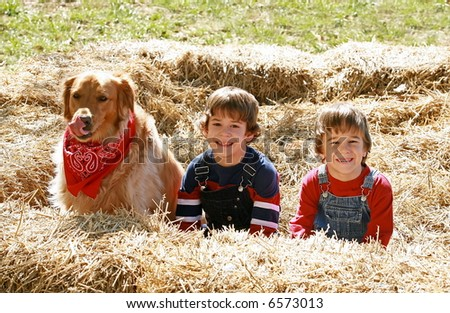 Little Farmers with Dog - stock photo