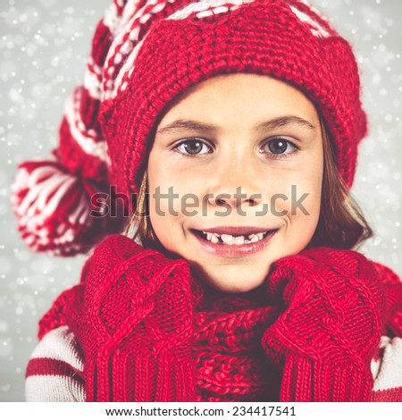 Little fashion girl in fashion Christmas clothes posing over white brick background, full length - stock photo
