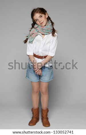 Little fashion girl in full length - stock photo