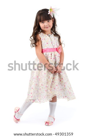 Little fashion model posin in studio.