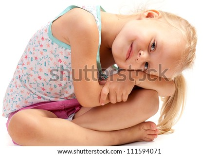 Little fashionable girl with blond hair
