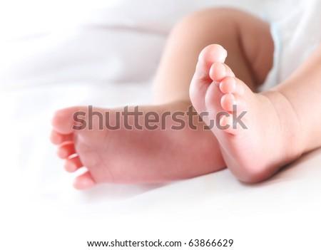Little feet, focus on the right foot - stock photo