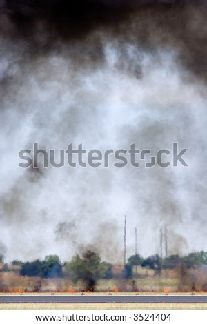 Little fire and lots of smoke - stock photo