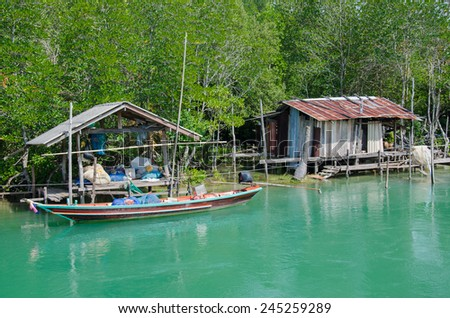 Little Fisherman's Cottage On The Clear River. - stock photo