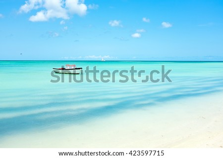 Little fishing boat in the caribbean sea on Aruba island