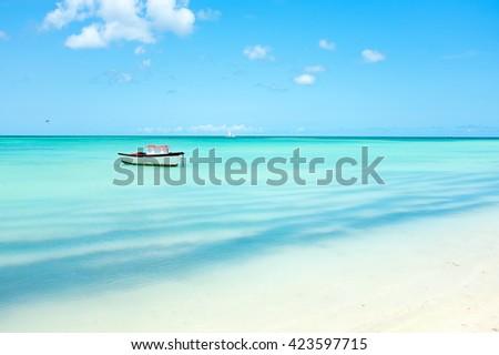 Little fishing boat in the caribbean sea on Aruba island - stock photo