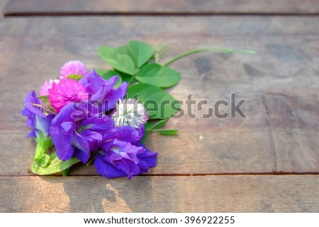 Little flowers bouquet on wood table background
