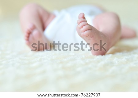 little foot of newborn baby in soft selective focus - stock photo