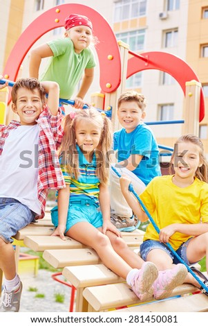 Little friends spending leisure on playground - stock photo