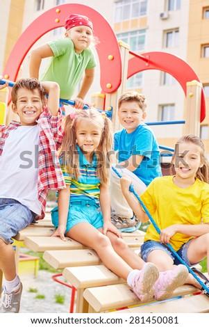 Little friends spending leisure on playground - stock photo