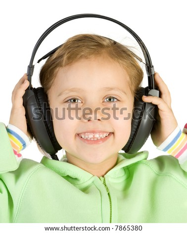 Little fun girl listening music with headphones. Isolate on white.