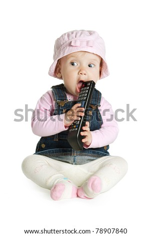 little funny baby girl with tv remote
