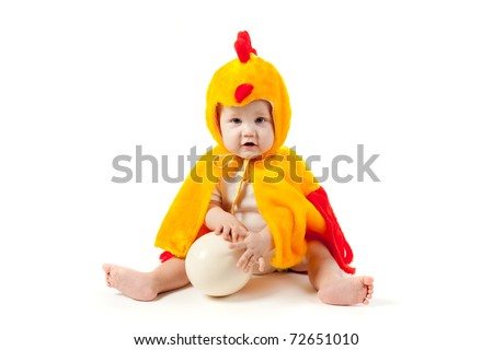little funny boy in chicken costume - stock photo