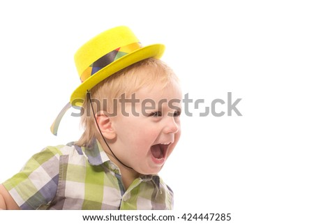 Little Funny boy in shirt and funny hat. Isolated on white background
