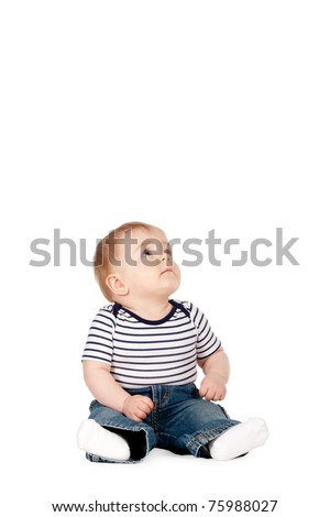 little funny boy looks up isolated on white - stock photo