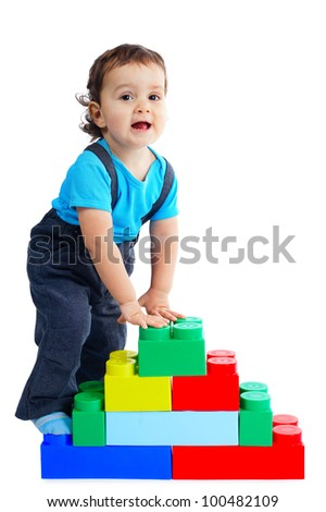 little funny boy plays with colorful cubes - stock photo
