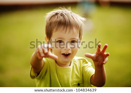 little funny boy scares - stock photo
