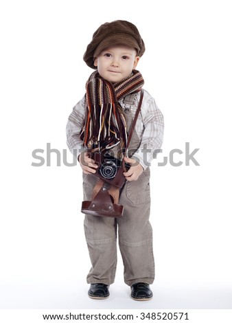 little funny boy with aged retro camera