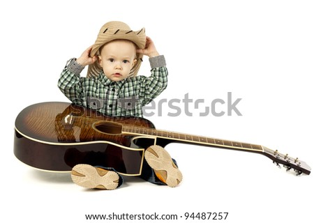 little funny boy with guitar - stock photo