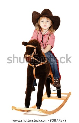 little funny cowgirl riding horse - stock photo