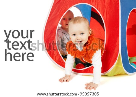 Little funny girl and boy in tent