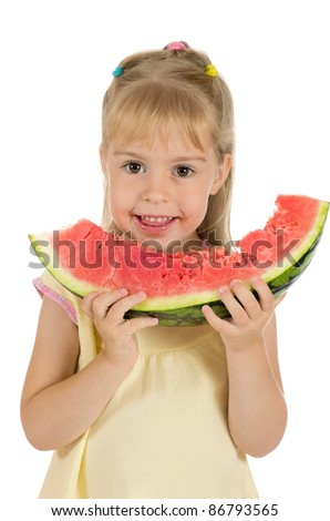 Little funny girl eating a watermelon. Healthy Eating. - stock photo