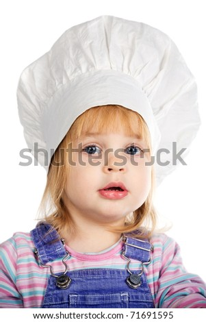 little funny girl in cook hat - stock photo